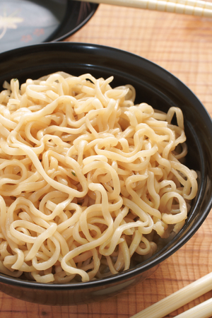 Ramen Noodles in lacquer bowls with chopsticks