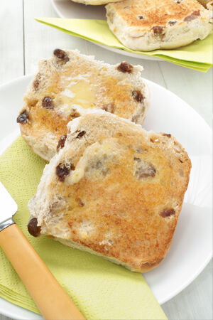 teacake: Hot buttered teacakes a traditional bun filled with raisins and spices