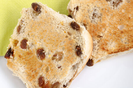teacake: Toasted Teacakes a traditional bun filled with raisins and spices Stock Photo