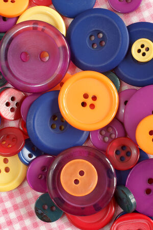 Pile of brightly colored buttons used in sewing and haberdashery photo