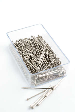 Box of sewing or textile pins studio isolated