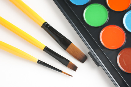 paintbox: Paint brushes and water color paints Stock Photo