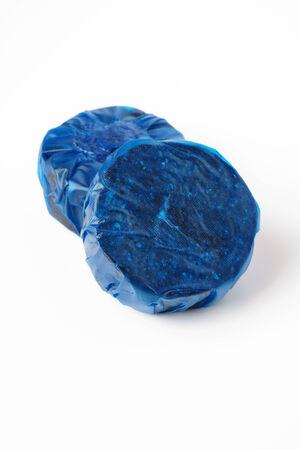 Blue soluble toilet cistern blocks studio isolated photo