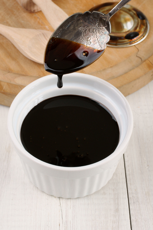 treacle: Black Treacle or molasses selective focus on the spoon Stock Photo