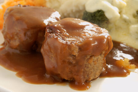 offal: Faggots a traditional dish in the UK made from pork and offal served in a thick gravy