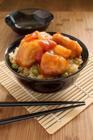 Sweet and sour chicken with fried rice photo