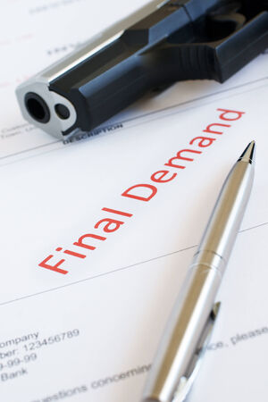 self harm: Overdue Invoice with final demand notification in red with a gun in the background