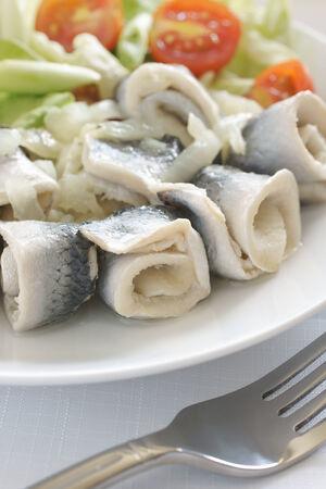 appetiser: Rollmops or pickled herring fillets served with salad a popular seafood in Northern Europe