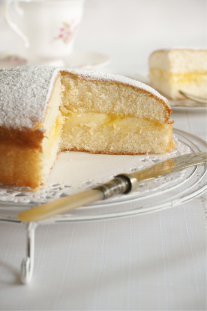 Sponge sandwich cake made with lemon curd and buttercream photo
