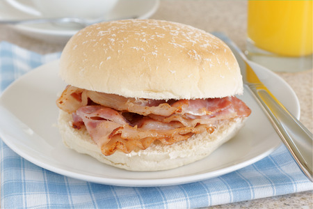 bacon fat: Bacon Sandwich or bacon roll Stock Photo