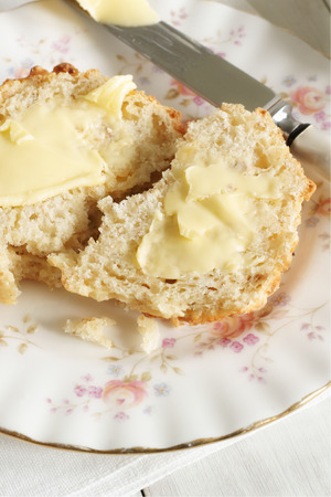 buttered: Freshly buttered scones Stock Photo