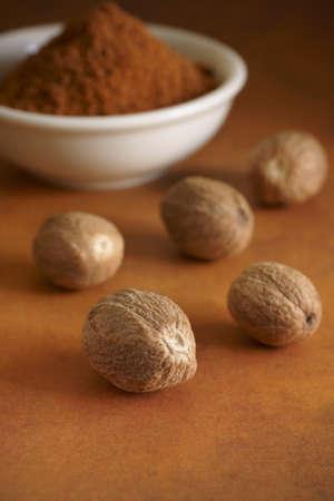 nutmeg: Whole and ground nutmeg Stock Photo