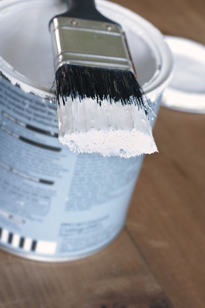 Painting and decorating a pot of white paint and brush Imagens
