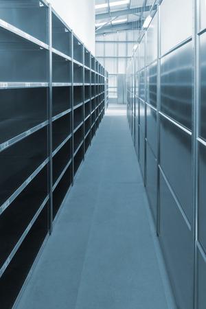 Empty warehouse storage shelves and racks photo