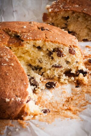 sultana: Traditionally home baked farmhouse sultana or dried fruit light sponge cake with a slice removed