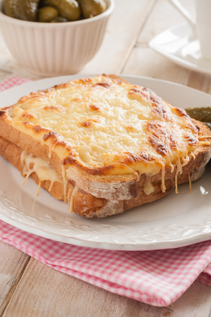 Croque Monsieur a traditional French toasted cheese and ham sandwich topped with bechamel sauce