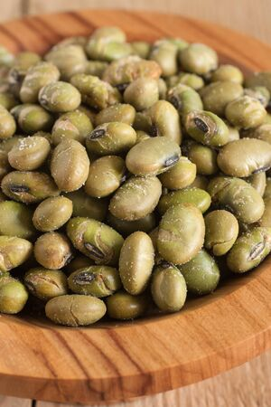 seasoned: Soya Nuts soy beans baked or roasted until crisp and brown then seasoned a crunchy snack