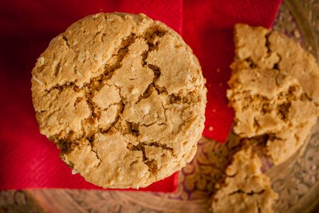 gingernuts: Ginger and treacle or molasses biscuits in a stack shot with low key lighting and shallow focus