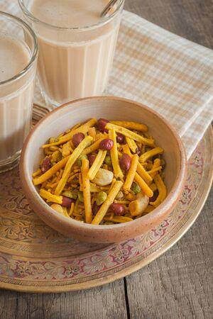 masala chai: Masala Chai and a bowl of spicy Bombay Mix