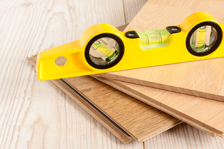 wood laminate flooring: Pieces of wood laminate flooring ready to be laid