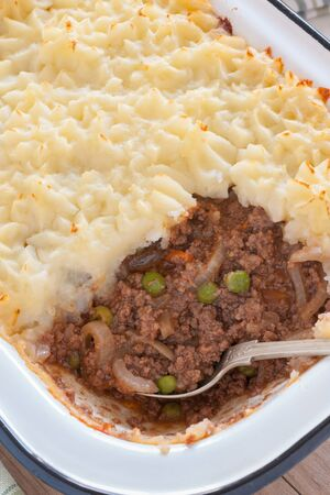 Cottage pie or shepherds pie a mince meat and vegetable pie with a topping of mashed potatoes