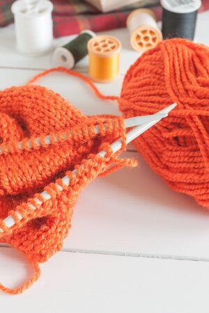 Knitting a cardigan or sweater with needles and balls of wool