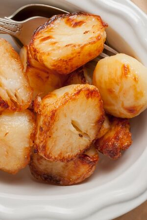dinners: Roast Potatoes cooked in beef fat until crisp and golden a favourite side dish with roast dinners
