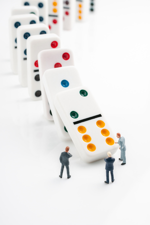 Domino effect or chain reaction concept of cascading errors or failure to make the right decisions