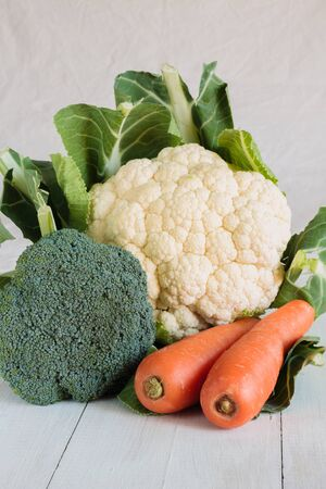 head of cauliflower: Cauliflower head broccoli and carrots useful for healthy eating  concepts