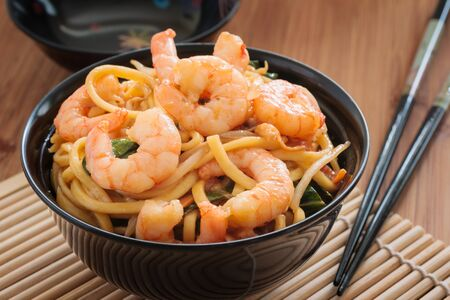 lo mein: Prawn Chow Mein or Lo Mein stir fried prawns with egg noodles vegetables and bean sprouts