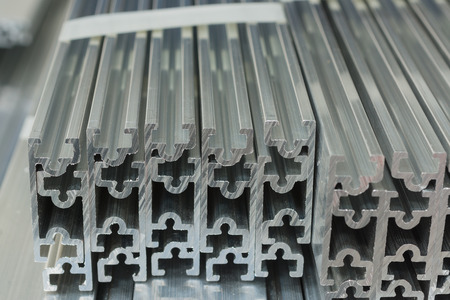 extrusion: Cross sections of extruded aluminium or aluminum channels for use in manufacturing and fabrication Stock Photo