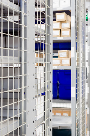 stock photo storage bins and industrial storage racks in a warehouse shot with shallow focus - Industrial Storage Bins