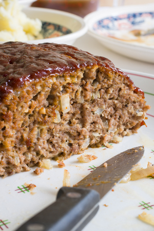 Classic American meatloaf made with ground beef oatmeal onions and a ketchup brown sugar and mustard glaze