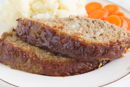 meatloaf: Classic American meatloaf made with ground beef served with mashed potatoes and carrot coins