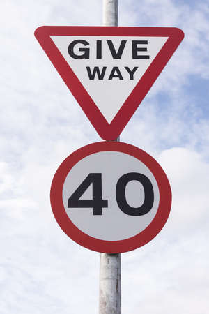 Urban 40 miles per hour speed limit and give way sign