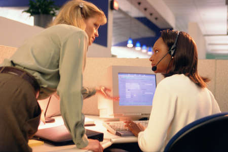 female executive in discussion with female computer operator Stock Photo - 897979