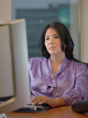 Female at desk typing on personal computer