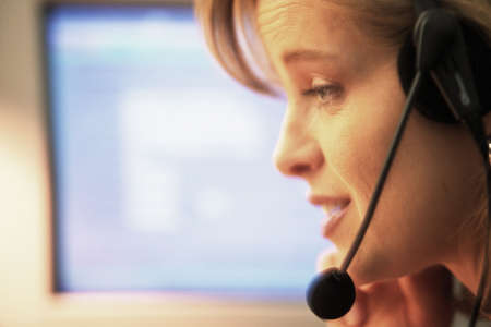 Woman with headset at computer
