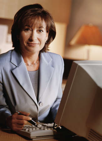 Portrait of businesswoman at her desk