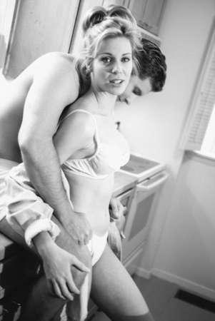 Black and white image of couple undressing