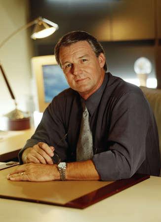 Portrait of businessman at his desk