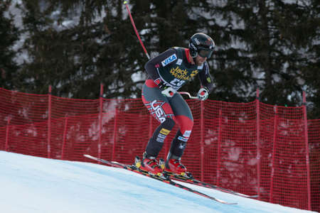 men s boot: VAL GARDENA - GROEDEN, ITALY 21 GANONG Travis  USA  competing in the Audi FIS Alpine Skiing World Cup MEN Editorial