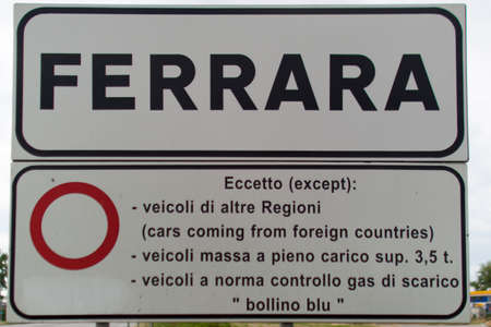 road sign with the name of the city ferrara Stock Photo