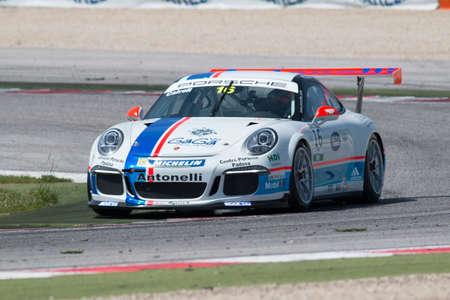 adriatico: MISANO ADRIATICO, Rimini, ITALY - May 10:  A Porsche 911 GT3 Cup of Antonelli Motorsport team, driven By CAIROLI Matteo (ITA), the ,Porsche Carrera Cup car racing on May 10, 2014 in Misano Adriatico, Rimini, Italy.