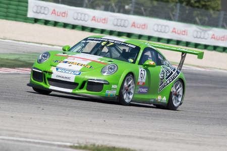 adriatico: MISANO ADRIATICO, Rimini, ITALY - May 10:  A Porsche 911 GT3 Cup of Dinamic team, driven By DE GIACOMINI Alex (ITA), the ,Porsche Carrera Cup car racing on May 10, 2014 in Misano Adriatico, Rimini, Italy.