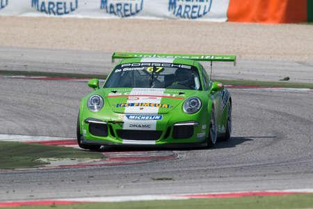 adriatico: MISANO ADRIATICO, Rimini, ITALY - May 10   A Porsche 911 GT3 Cup of Dinamic team, driven By DE GIACOMINI Alex  ITA , the ,Porsche Carrera Cup car racing on May 10, 2014 in Misano Adriatico, Rimini, Italy