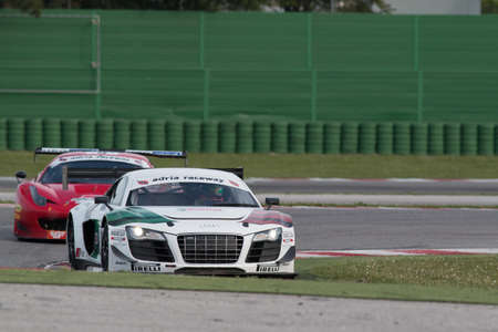 ger: MISANO ADRIATICO, Rimini, ITALY - May 10:  A AUDI R8 LMS of Audi Sport Italia team, driven By MAPELLI Marco (ITA) and  SCHOEFFLER Thomas (GER),  the , C.I. Gran Turismo car racing on May 10, 2014 in Misano Adriatico, Rimini, Italy.