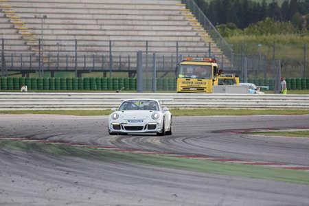 adriatico: MISANO ADRIATICO, Rimini, ITALY - May 10:  A Porsche 911 GT3 Cup of Gt Motorsport team, driven By BEN WALTER (ITA), the ,Porsche Carrera Cup car racing on May 10, 2014 in Misano Adriatico, Rimini, Italy.