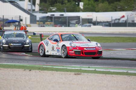 carrera: MISANO ADRIATICO, Rimini, ITALY - May 10:  A Porsche 911 GT3 Cup of Ghinzani Arco Motorsport team, driven By CASSARÀ Marco (ITA), the ,Porsche Carrera Cup car racing on May 10, 2014 in Misano Adriatico, Rimini, Italy.