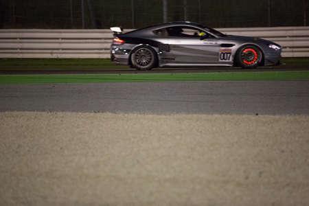 adriatico: MISANO ADRIATICO, Rimini, ITALY - May 10:  A Aston Martin Vantage GT4 of ALFAB RACING team, driven By ROOS Daniel (SWE) and BEHRENS Erik (SWE),  the GT4 European Series car racing on May 10, 2014 in Misano Adriatico, Rimini, Italy.
